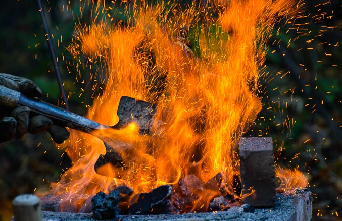 fire with shovel